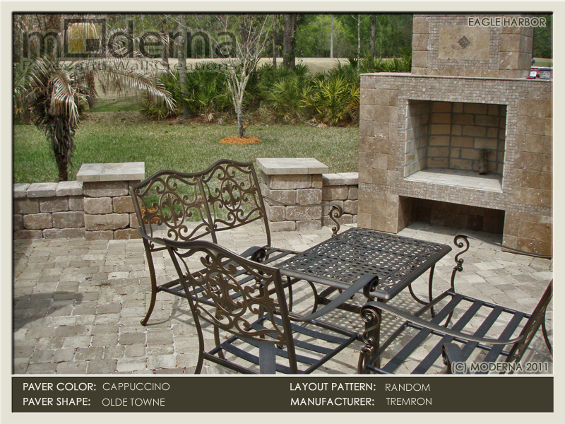 Ourdoor living area with pavers, fire place, seat wall, and columns. The pavers here are Olde Towne style in the Cappuccino color. Jacksonville FL.