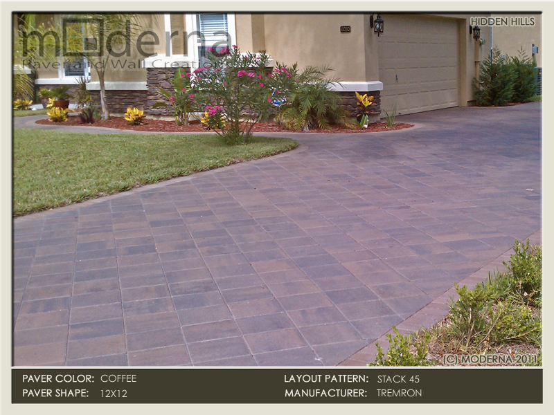 Paver driveway in 12 x 12 square Plaza series pavers. The driveway is laid in a diagonal 45 degree pattern. Bordered with 4 x 8 soldier course.