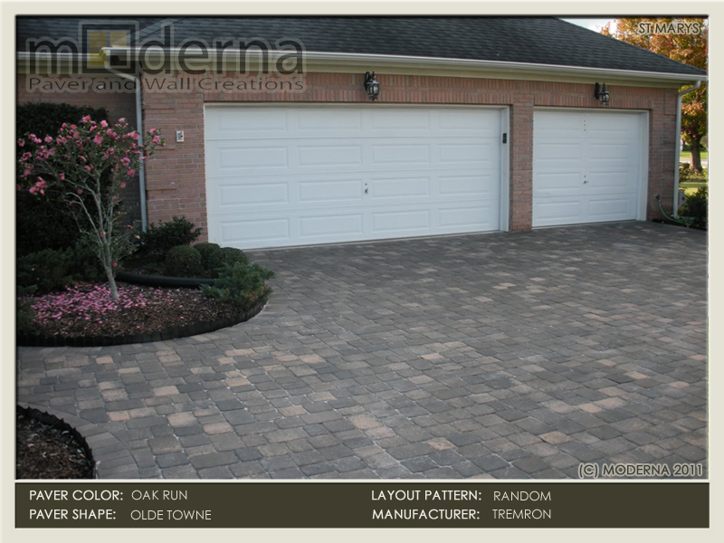 The Oak Run color is Grey and Tan with a subtle amount of Coral. The coral comes out just a bit in this photo of a brick paver driveway installation.