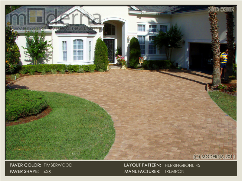 Timberwood color paver driveway in 4 x 8 shape with the Herringbone pattern. The 4 x 8 pavers were also used as a raised edge around the plant beds.