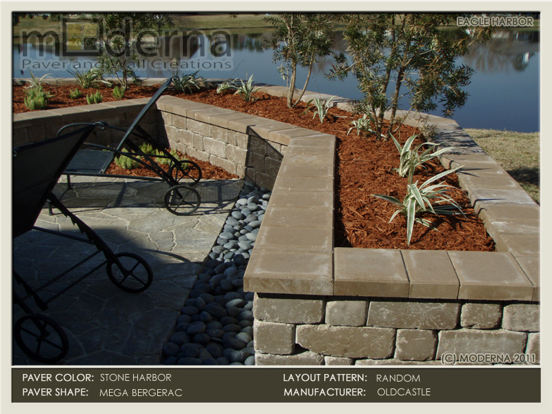 This hardscape construction project features a seat wall  surrounding the paver patio that also serves as a plant bed. The pavers are Mega Arbel in Stone Harbor.