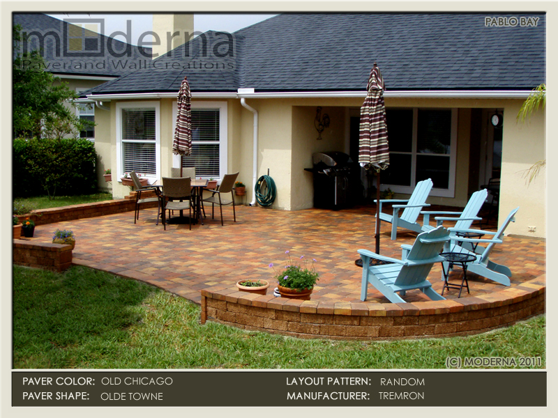 This paving stone patio features a small retaining wall around the perimeter with a small opening facing the lake. Olde Chicago color.