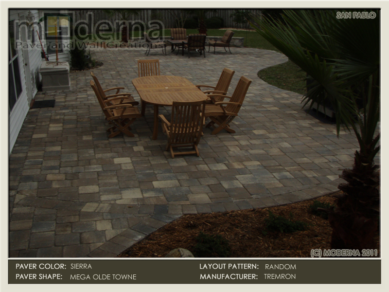 Teak dining set on this paver patio in Jacksonville FL. The pavers are Mega Olde Towne in Sierra color. A seating wall on the far side.