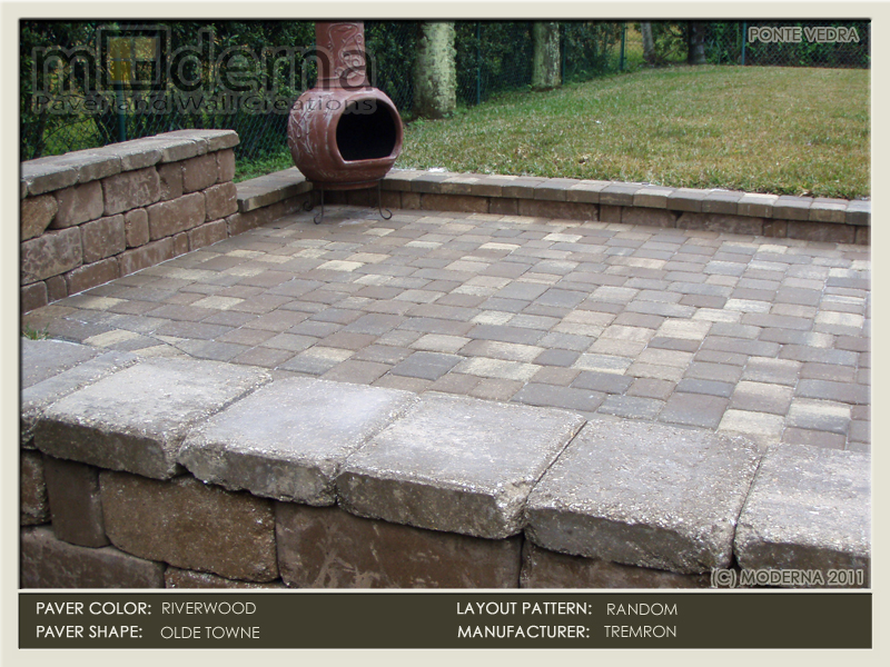A small stone patio in Ponte Vedra Beach FL. The pavers are Olde Towne Riverwood and wall is Tan in color and tumbled Stonegate style.