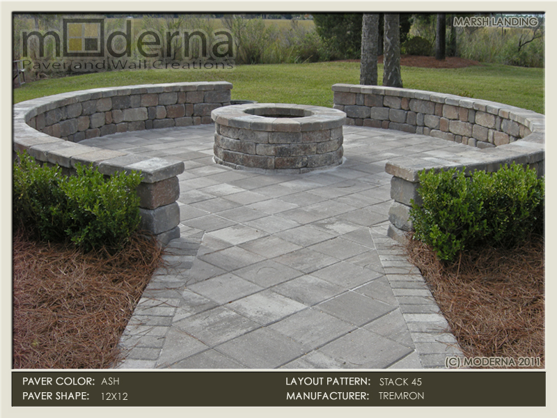 A paver patio and seating wall arounding a fire pit overlooking the marsh and intracoastal in Marsh Landing Golf and Country Club.