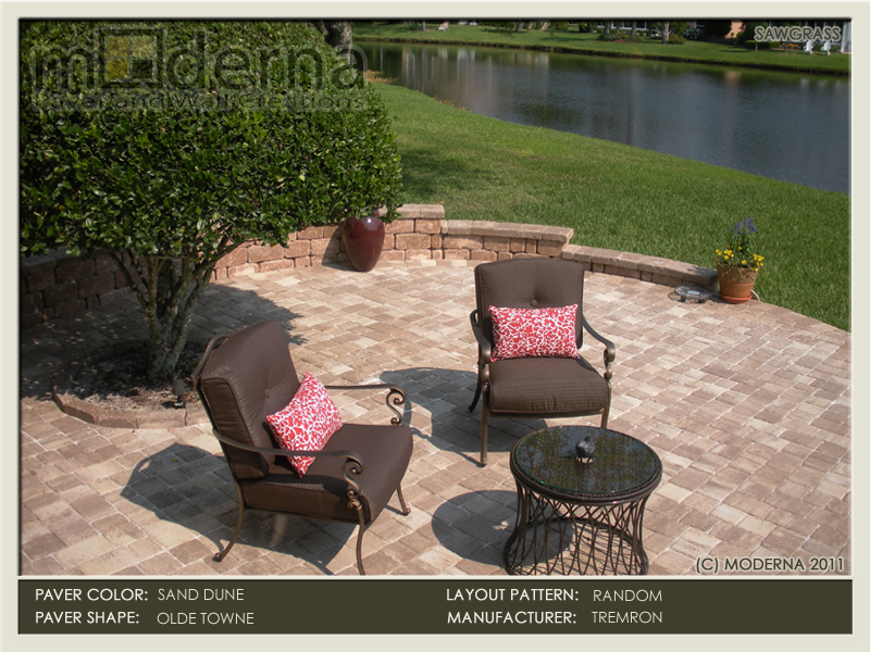 A 3 tiered seating wall overlooking the lake in Marsh Landing FL. The pavers, wall, edging, and cap are all Sand Dune color.