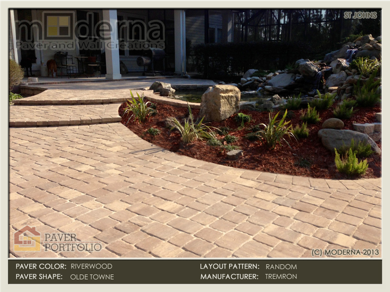 A terraced paver patio with steps that lead around a koi pond with waterfall. Riverwood color, three piece olde towne pavers. St Johns County.