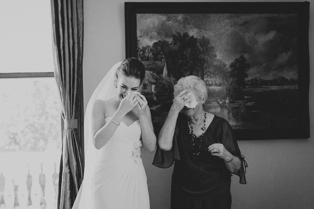 candid wedding photography of Bride and Grandma both full of emotion