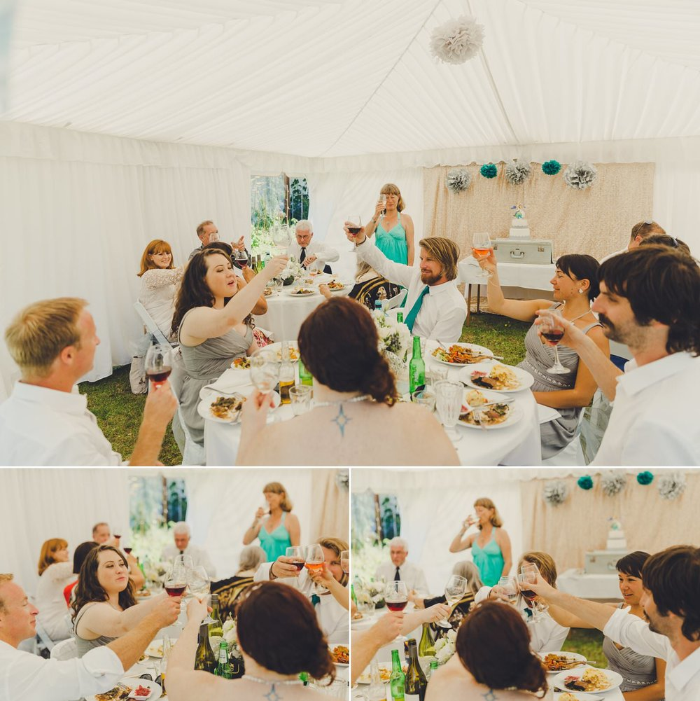 Wedding guests in a marquee making a toast