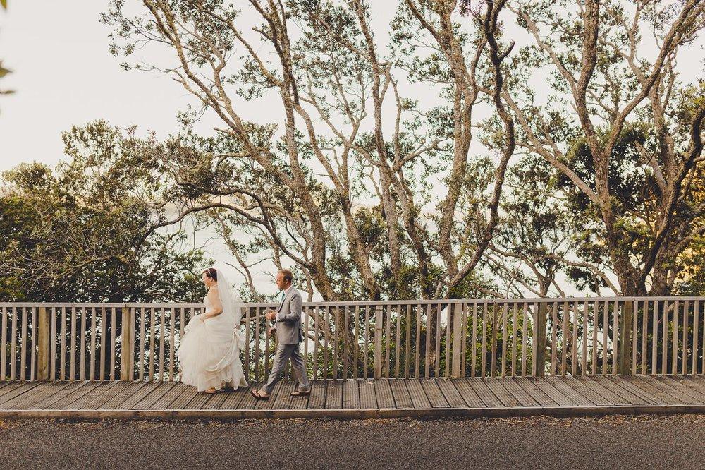 Couple walking down the road in Coromandel wearing Jandals