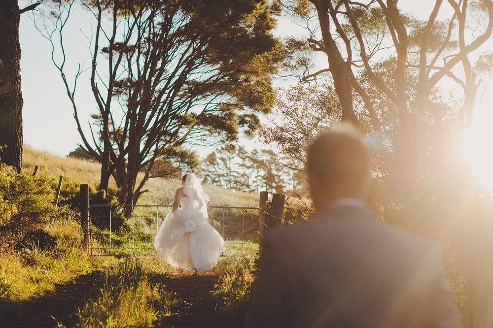 Coromandel wedding photographer couple walking in the sunset