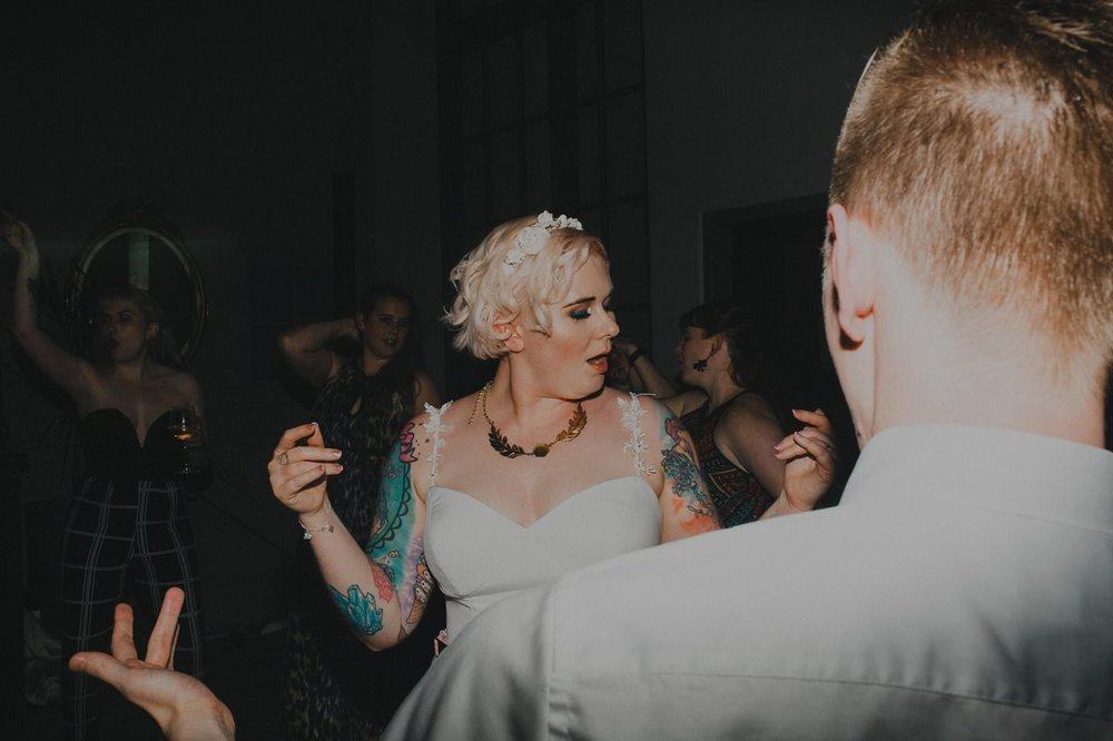 Tattooed bride dancing