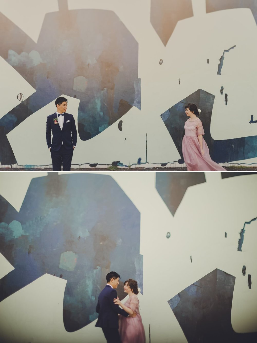 Modern industrial wedding photos with bride and groom in front of a graffiti wall. Hipster Wedding