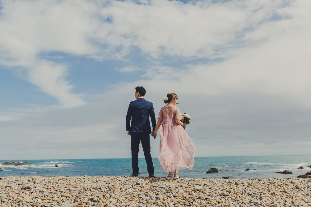 Wedding photography at Wellington's south coast on a summer day with blue skies