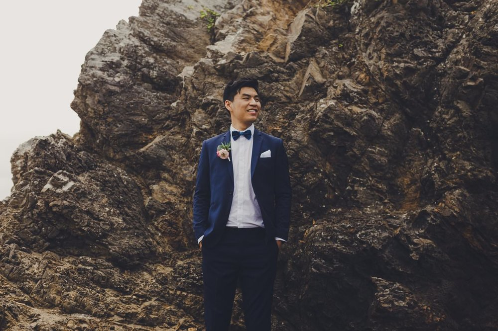 Stylish Chinese groom wearing royal blue Barkers suit