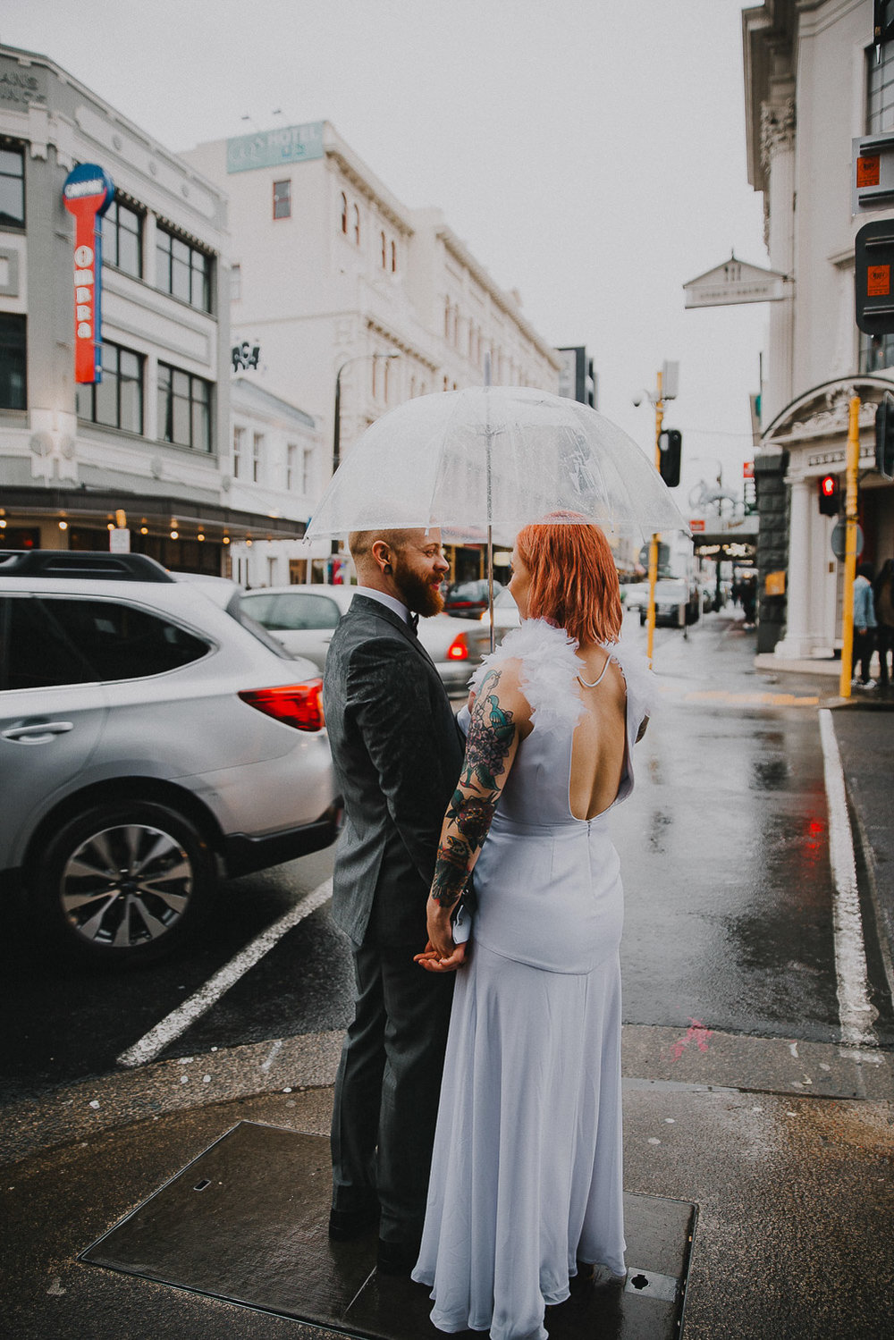 Romantic photo of  modern city wedding in the rain