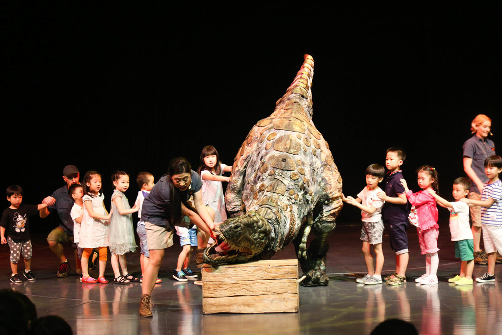 Alice, a T-Rex, and a LOT OF children, mostly chosen, some who just ran up to the stage of their own accord.