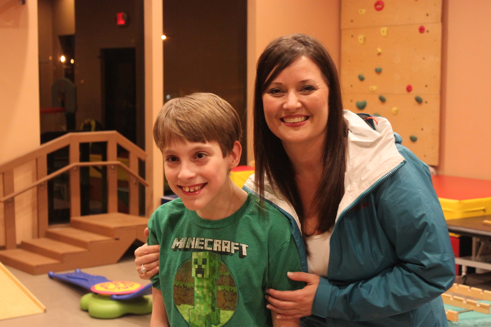 Kim Smith, MMC's Director of Marketing, pictured with Special Kids child, Ivan