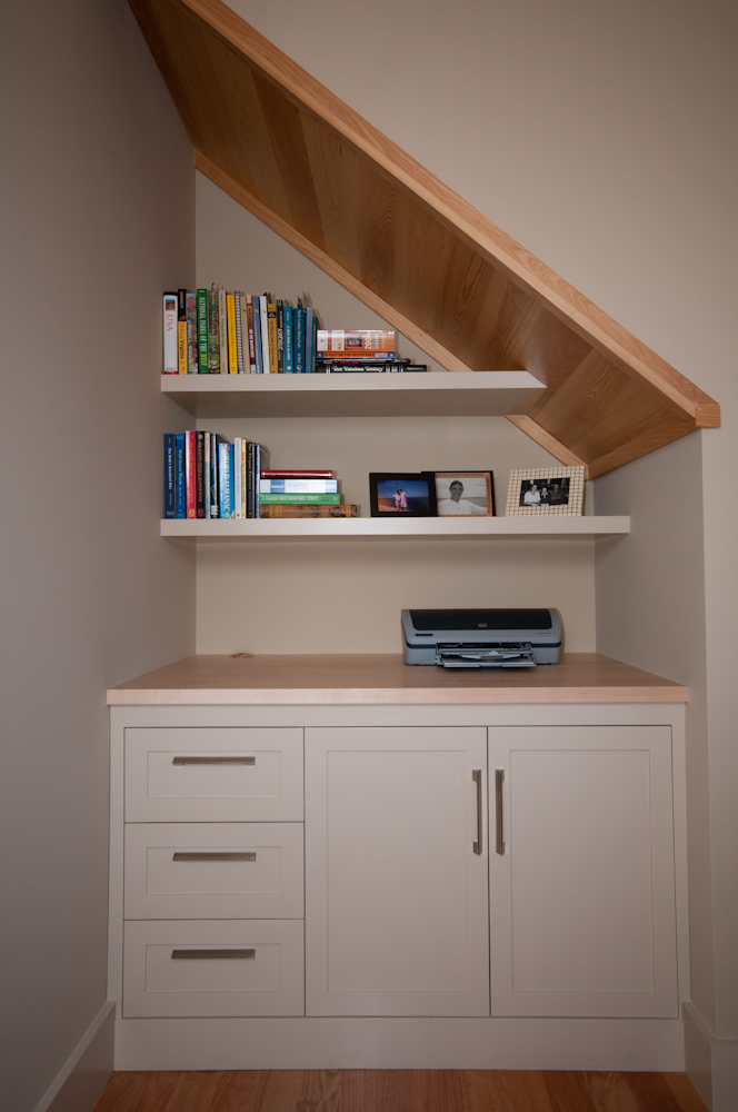 Cubby Hole Built -In. Nice simple lines and floating shelves really set this niche apart. Painted poplar cabinet and shelves with hard maple top.