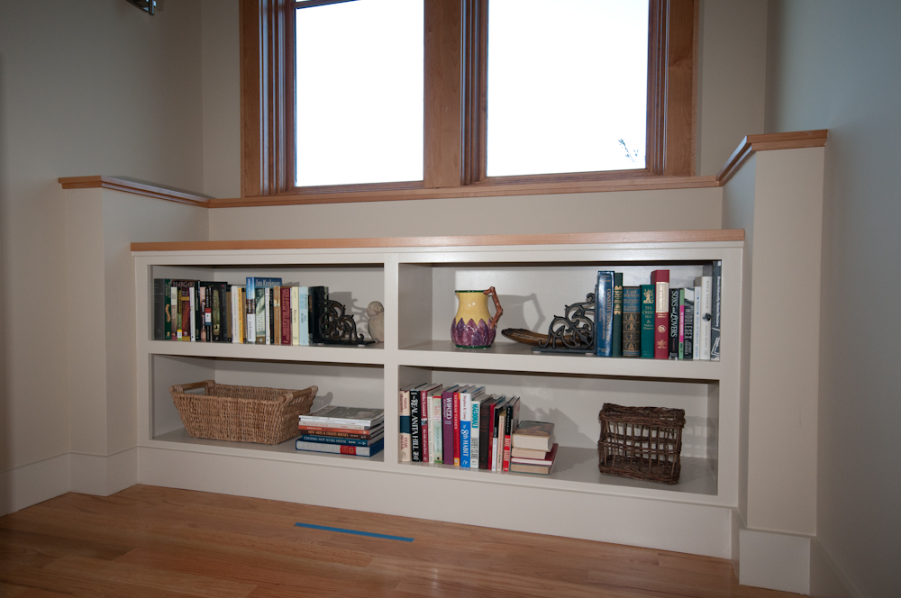 Bookshelf on Stair Landing. Painted poplar with hard maple tops.