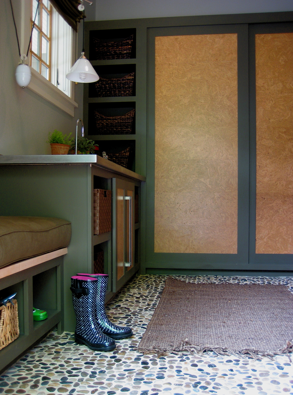 Pantry/Mudroom at Southern Living Idea Home Davidson Gap. Painted poplar cabinets with cork inlays in the doors for notes, and a river stone   floor.