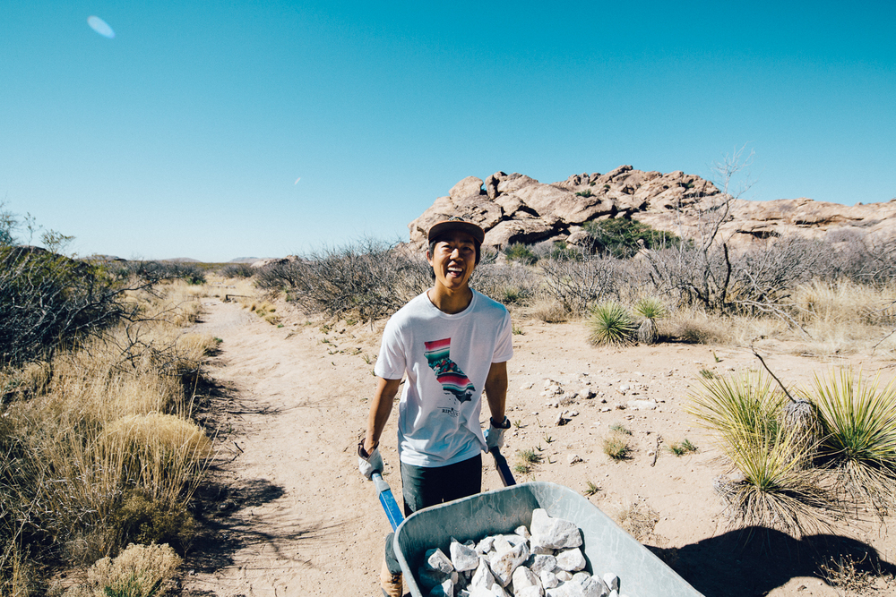 Ben Lim volunteering for the Access Fund Conservation Team in Hueco Tanks, Texas.  Michael Lim Photography 2015 ©