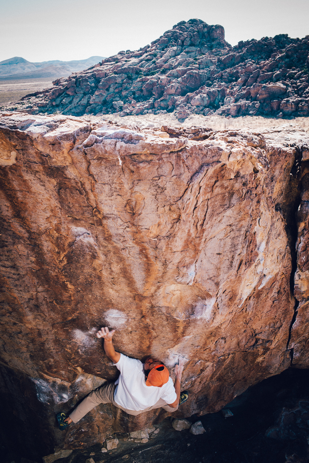 Ben Lim projecting Baby Face, a v7 boulder in Hueco Tanks, El Paso Texas.  Michael Lim Photography 2015 ©