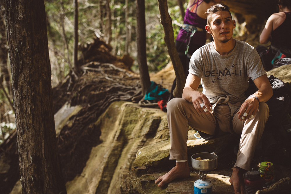 Carlos R. Flores, DE-NA-LI brand ambassador preparing lunch in between sends at the Roadside Crag, Red River Gorge.