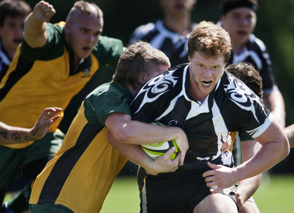 Rochester Institute of Technology's Christian Blank muscles through several Paul Smith's College defenders during the school's first Rugby match in 5 years.