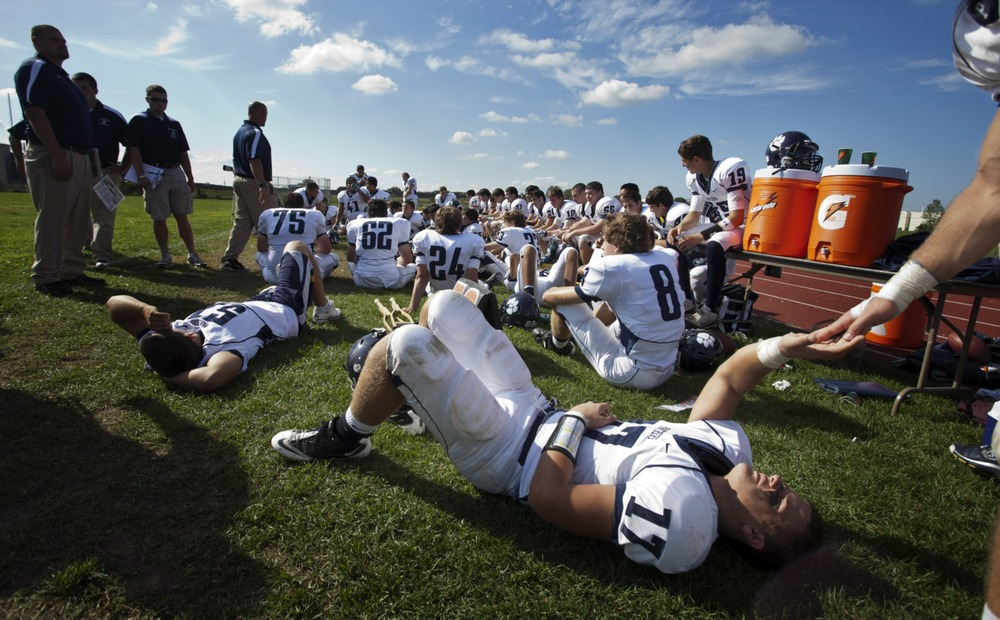 Pittsford Junior Wide Reciever Glynn Molinich recovers during halftime with his teammates before going on to shut out opponent Edison Tech 42-0 in Rochester, New York.