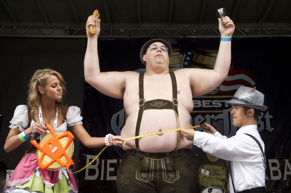 Participants have their stomachs measured in the Beer Belly Contest at Baltimore Beer Week's Das Best Oktoberfest at M&T Bank Stadium in downtown Baltimore. 2013