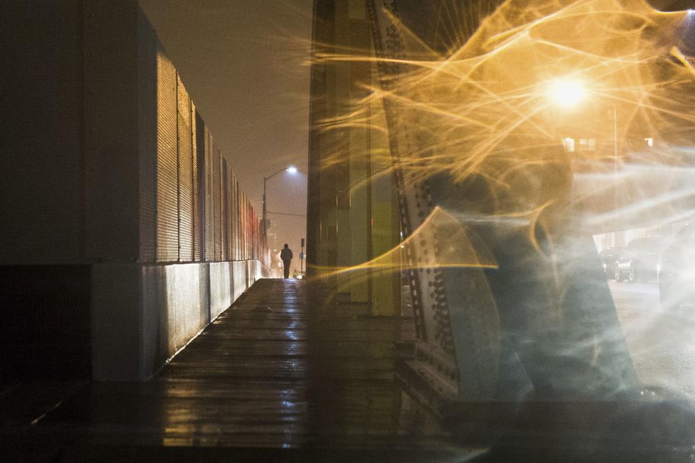 A rainy night on the Guilford Avenue bridge over I-83.
