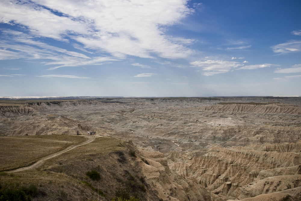 Larry makes some photographs of tourists enjoying the view of the Badlands in South Dakota.