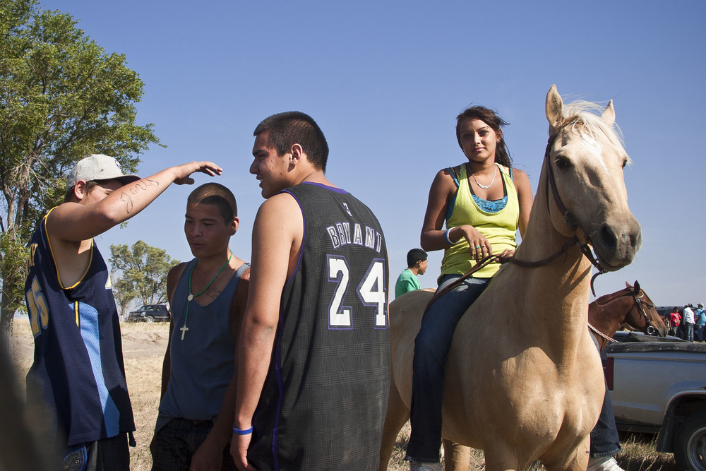 Oglala Sioux teenagers mingle during an impromptu Rodeo on the Pine Ridge reservation, nearing the border of Nebraska and South Dakota.