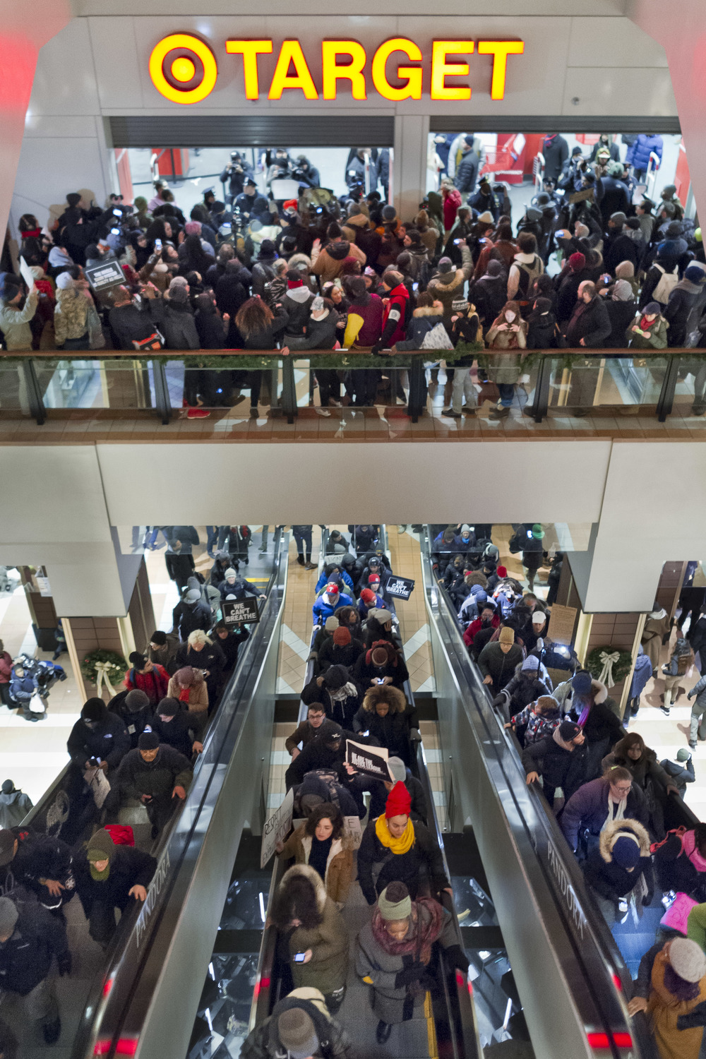 Protestors flood the escalators at the Atlantic Terminal in Brooklyn, forcing Target to close their doors.
