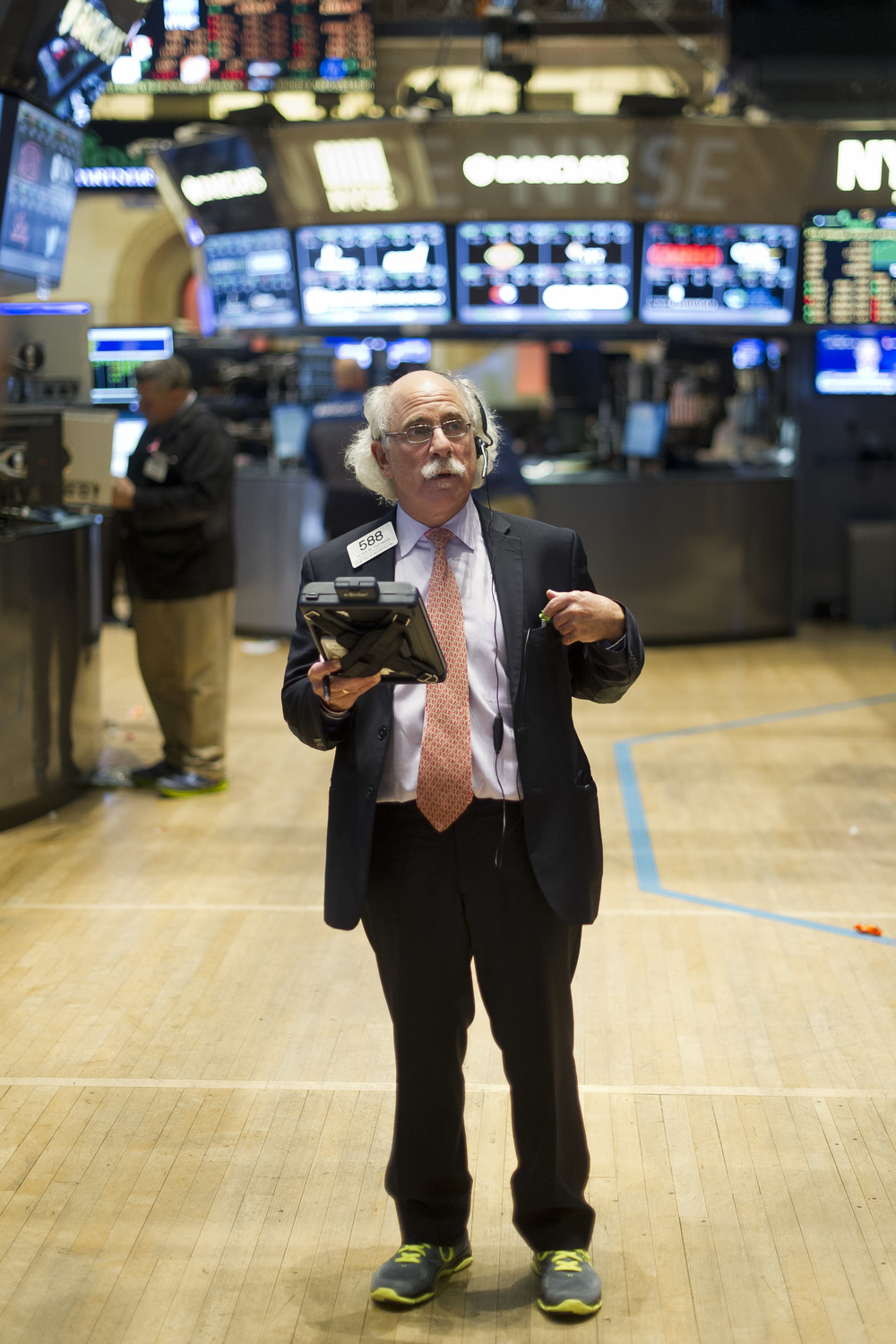Peter Tuchman of Quattro M. Securities, Inc., pauses to gather his thoughts as the markets close on Friday, October 31st 2014 at the New York Stock Exchange.