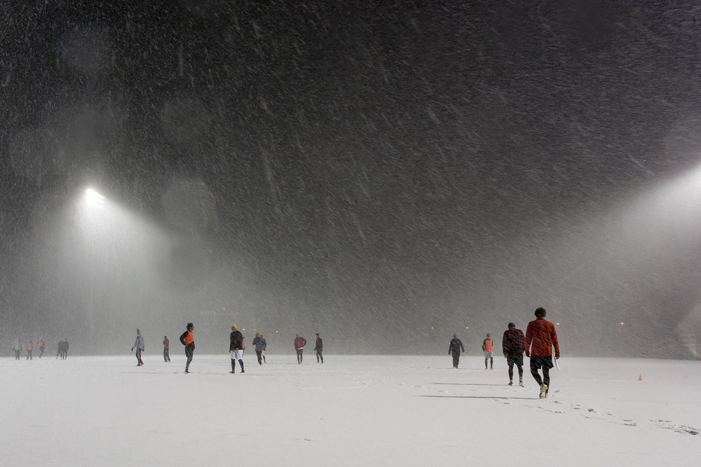 Bates Ultimate Frisbee practice is blanketed by an early spring snowstorm.