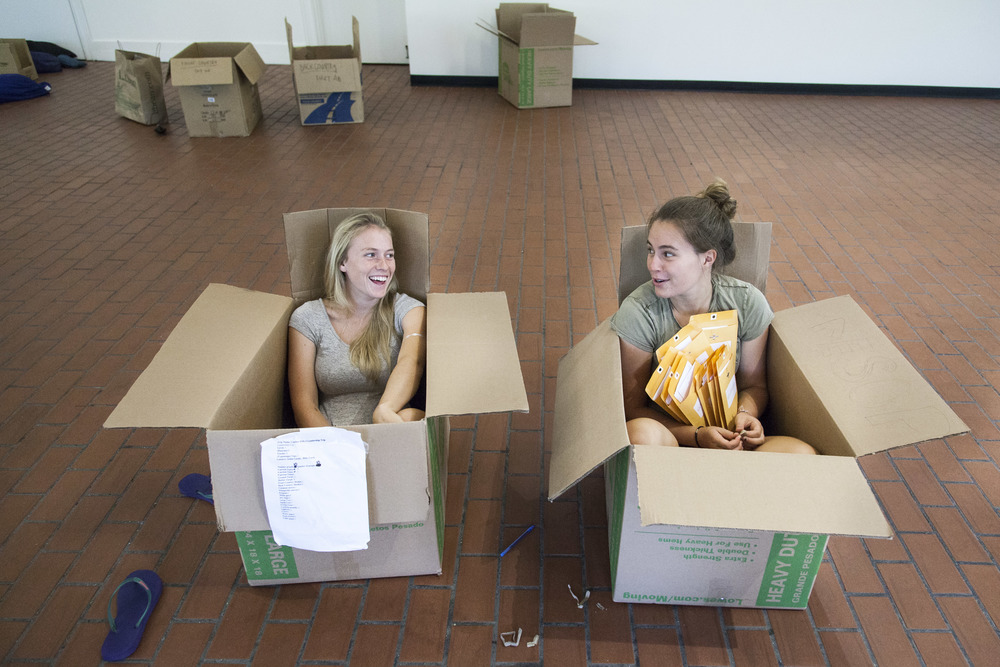AESOP Coordinators Nat Silver '16 (L) of Bennington, Vermont and Sasha Lennon '16 (R) of Cape Elizabeth, Maine, find comfortable seating in which to distribute materials to trip leaders.