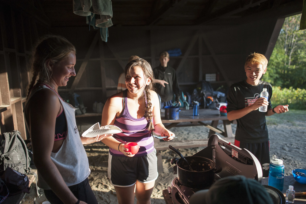 (L to R) Amanda Mele '19 of Newtown, Connecticut jokes with Ceria Kurtz '19 of Jakarta, Indonesia and Edward James '19 of Scarborough, Maine during their orientation camping trip.