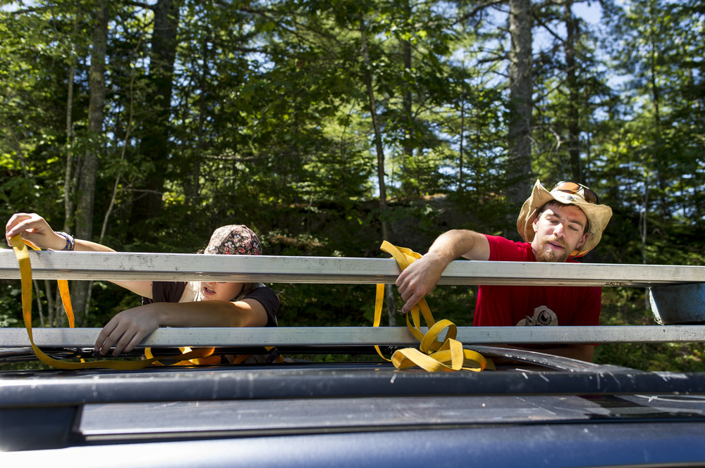 Geology majors Cailene Gunn '16 (left) of Granby, Conn., and Dana Cohen-Kaplan '16 of Newton, Mass., secure benches to the top of Gunn's car before heading out to do fieldwork at Long Marsh in Harpswell. The distance from Shortridge to Long Marsh is just 10 miles as the crow flies, but it's 30 miles (and a 45-minute drive) on roads that follow Maine's infamously zig-zaggy shoreline.