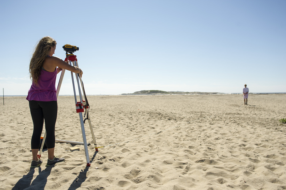 At Popham Beach State Park, Nicole Cueli '16 of Fort Lauderdale, Fla., sets up an a transit, or autolevel, a device used by scientists, builders, and surveyors to measure distances and elevation changes. In the distance at right is Ian Hillenbrand '17 of Terrace Park, Ohio.
