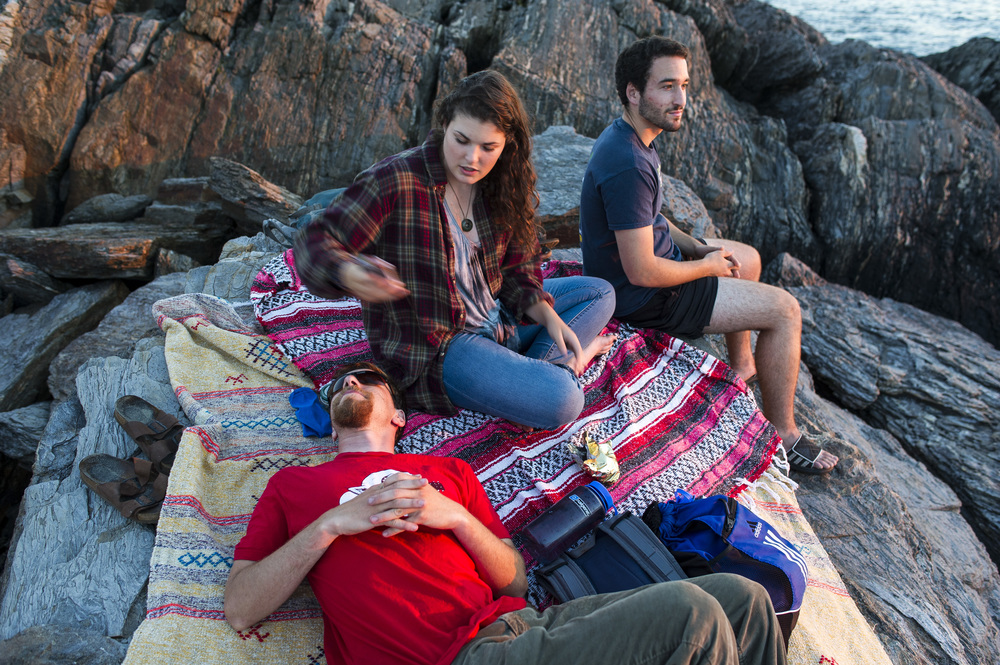 Gunn and Cohen-Kaplan join Adam Auerbach '16 of Silver Spring, Md. on Hermit Island., about three miles from Shortridge, where they watch the sunset from a spot called the Bath Tub.