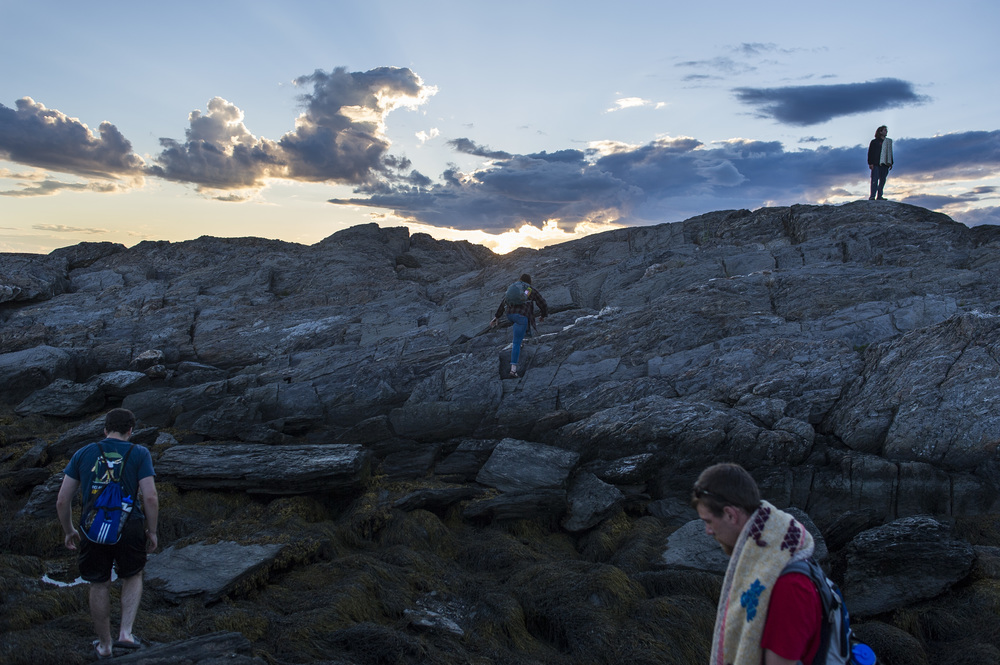 Gunn and Cohen-Kaplan join Adam Auerbach '16 of Silver Spring, Md., and Nathan Stephansky '17 of Whitman, Mass., on Hermit Island., about three miles from Shortridge, where they watch the sunset from a spot called the Bath Tub. The four students, each of whom did fieldwork or related coastal work over the summer, used Shortridge as their home base.