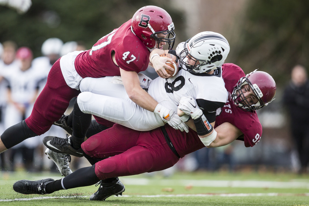 Max Breschi and Tucker Oniskey throw Noah Nelson for a loss in Bates' 31-0 win over Bowdoin for the 2015 CBB Championship.
