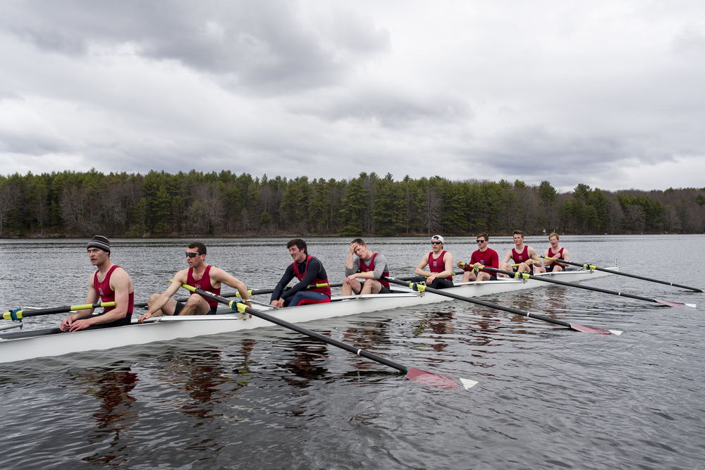 The Bates Men's rowing team rests on the Androscoggin River after a race.