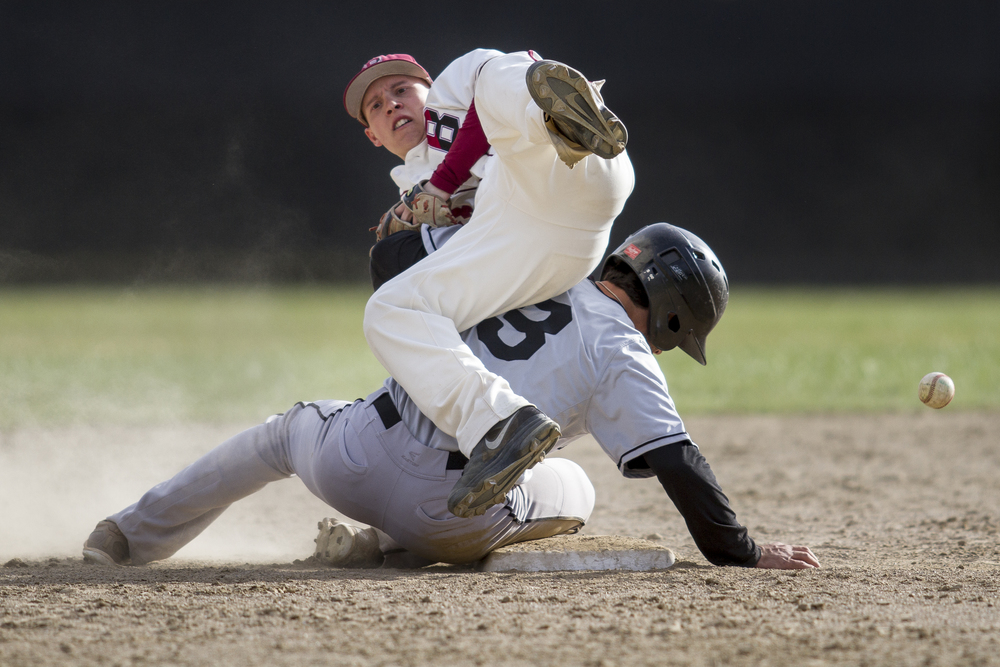 Bowdoin breaks up a double play as Bates shortstop Brendan Fox '17 loses the ball.