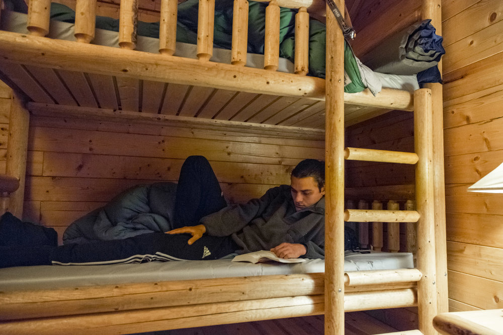 Owen Ahlborn '18 reads before getting some rest in West Yellowstone.