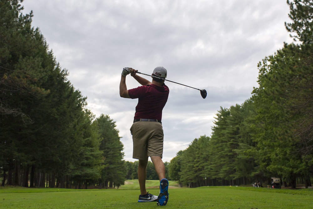 Golf captain Brad Rutkin '17 tees off during practice at Martindale Country Club in Auburn, ME.
