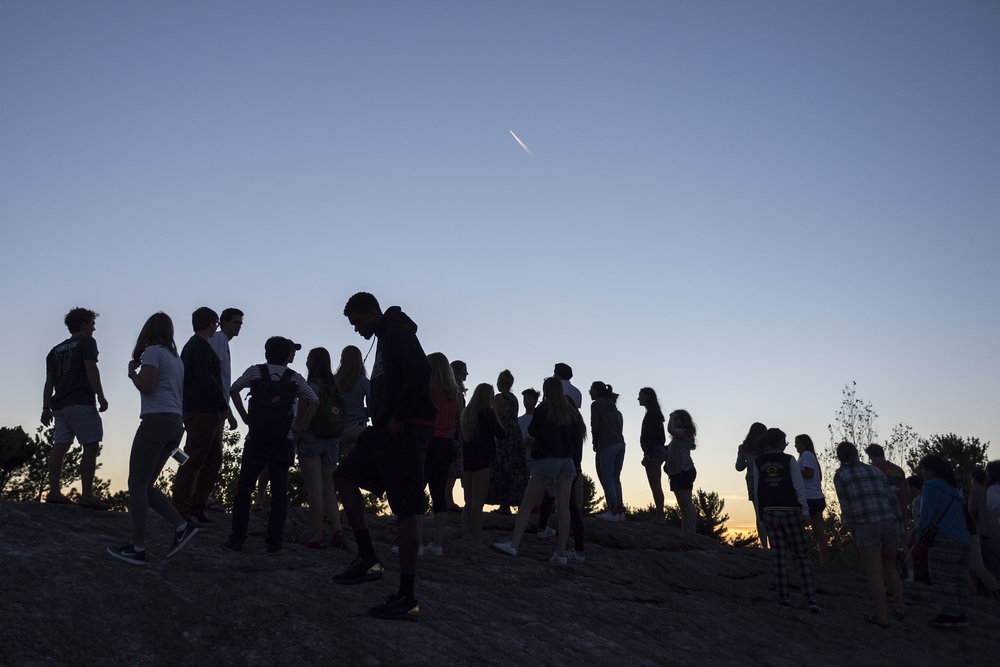First year students scale Mount David to view the sunset as they enter the first night of their Bates experience on August 29th 2016.