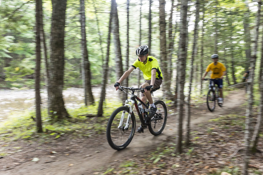 Sam Onion '20 cruises through the bike trails near Sugarloaf Mountain in Carrabassett Valley, Maine on Friday September 2 2016.